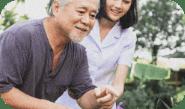 Senior man with female caretaker
