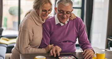 senior couple researching