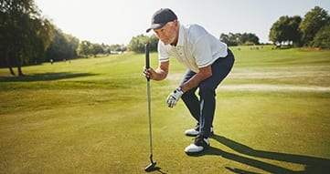 older adult out golfing in retirement