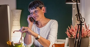 female retiree on computer