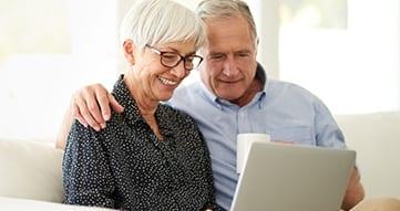 senior couple doing research on senior living