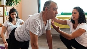 older adult man doing stretches