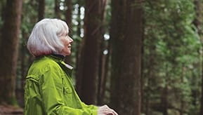 older woman with sequoia trees