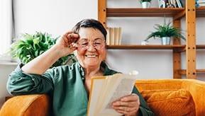 senior woman reading favorite book